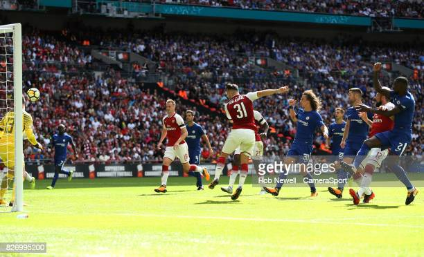 Arsenal's Sead Kolasinac scores his side's first goal during the FA Community Shield match between Arsenal and Chelsea at Wembley Stadium on August 6...