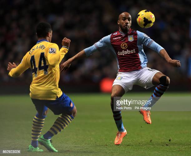 Arsenal's Serge Gnabry and Aston Villa's Fabian Delph battle for the ball