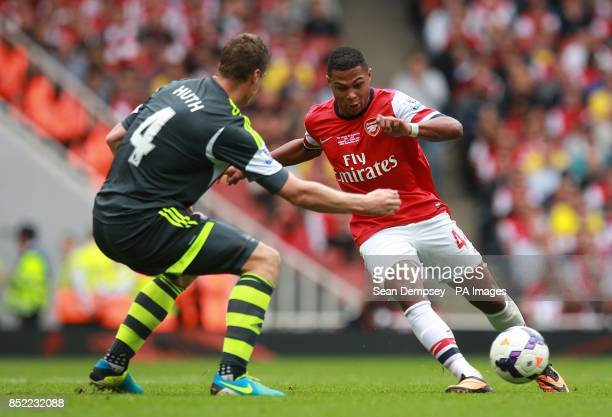Arsenal's Serge Gnabry and Stoke City's Robert Huth in action