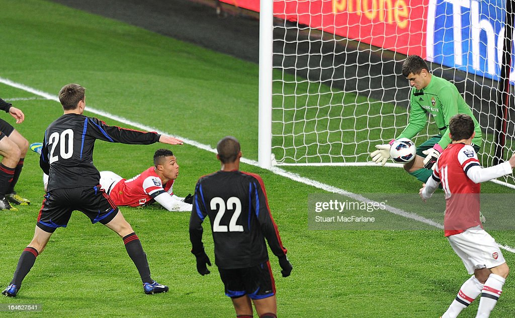 Arsenal's Serge Gnabry (2R) looks on as his header appears to have crossed the line as CSKA goalkeeper Sergey Revyakin attenpts to save during the NextGen Series Quarter Final match between Arsenal and PFC CSKA at Emirates Stadium on March 25, 2013 in London, England.