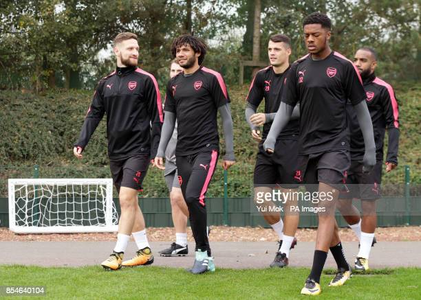 Arsenal's Shkodran Mustafi and Mohamed Elneny during the training session at London Colney