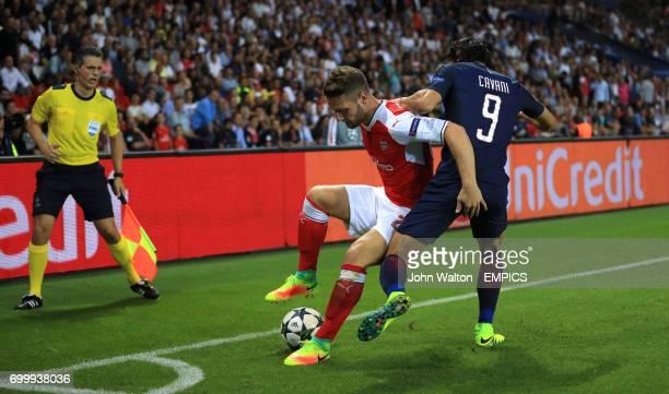 Arsenal's Shkodran Mustafi and Paris SaintGermain's Shkodran Mustafi battle for the ball