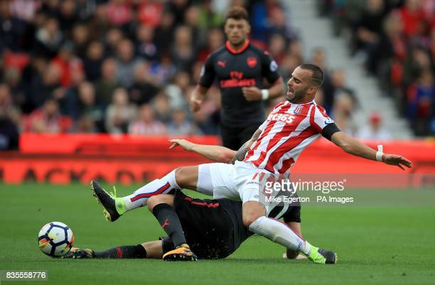 Arsenal's Shkodran Mustafi and Stoke City's Jese Rodriguez battle for the ball during the Premier League match at the bet365 Stadium Stoke