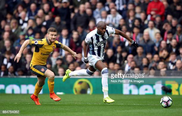 Arsenal's Shkodran Mustafi and West Bromwich Albion's Allan Nyom during the Premier League match at The Hawthorns West Bromwich
