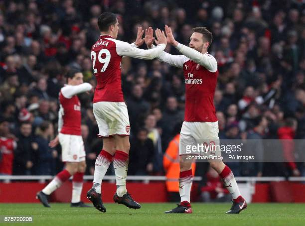 Arsenal's Shkodran Mustafi celebrates scoring his side's first goal of the game with Granit Xhaka during the Premier League match at the Emirates...