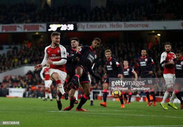 Arsenal's Shkodran Mustafi flicks the ball towards goal during the Premier League match between Arsenal and Huddersfield Town at Emirates Stadium on...