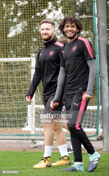 Arsenal's Shkodran Mustafi shares a joke with Mohamed Elneny during the training session at London Colney
