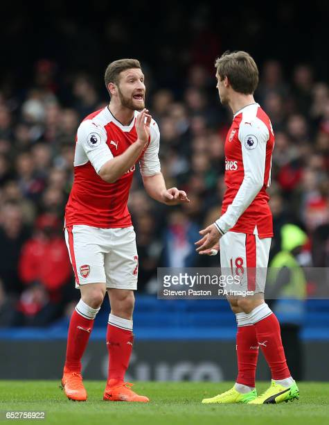 Arsenal's Shkodran Mustafi speaks with teammate Nacho Monreal