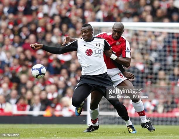Arsenal's Sol Campbell and Fulham's Stefano Okaka battle for the ball