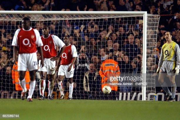 Arsenal's Sol Campbell Lauren and David Seaman stand dejected after the equalising goal scored by Chelsea's Frank Lampard