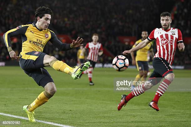 Arsenal's Spanish defender Hector Bellerin crosses the ball away from Southampton's English midfielder Sam McQueen during the English FA Cup fourth...