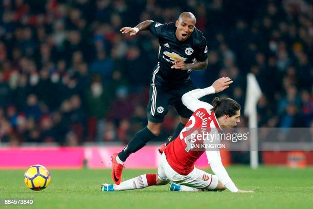 Arsenal's Spanish defender Hector Bellerin fouls Manchester United's English midfielder Ashley Young during the English Premier League football match...
