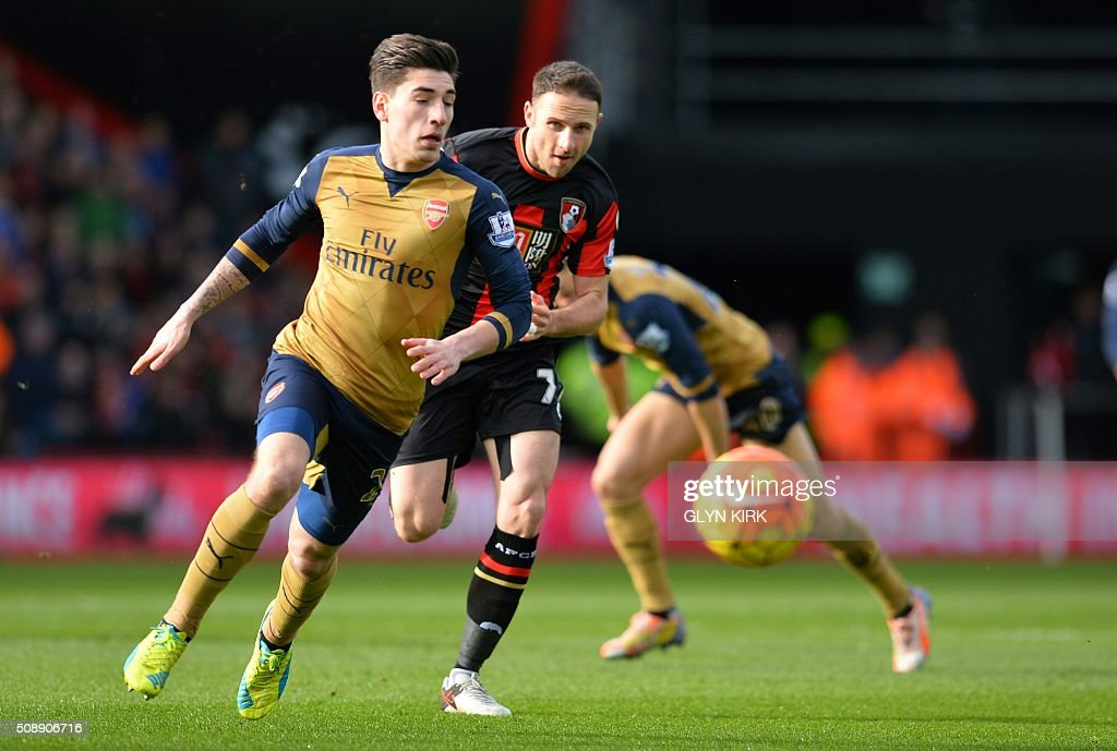 Arsenal's Spanish defender Hector Bellerin (L) vies with Bournemouth's English midfielder Marc Pugh during the English Premier League football match between Bournemouth and Arsenal at the Vitality Stadium in Bournemouth, southern England on February 7, 2016. / AFP / GLYN KIRK / RESTRICTED TO EDITORIAL USE. No use with unauthorized audio, video, data, fixture lists, club/league logos or 'live' services. Online in-match use limited to 75 images, no video emulation. No use in betting, games or single club/league/player publications. /