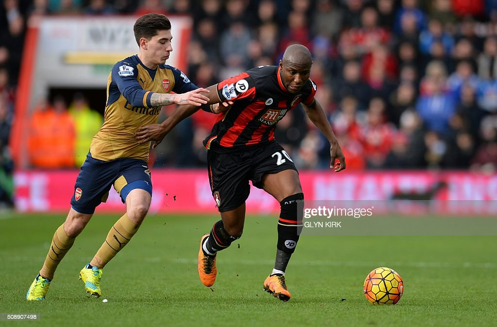 Arsenal's Spanish defender Hector Bellerin (L) vies with Bournemouth's English striker Benik Afobe during the English Premier League football match between Bournemouth and Arsenal at the Vitality Stadium in Bournemouth, southern England on February 7, 2016. / AFP / GLYN KIRK / RESTRICTED TO EDITORIAL USE. No use with unauthorized audio, video, data, fixture lists, club/league logos or 'live' services. Online in-match use limited to 75 images, no video emulation. No use in betting, games or single club/league/player publications. /