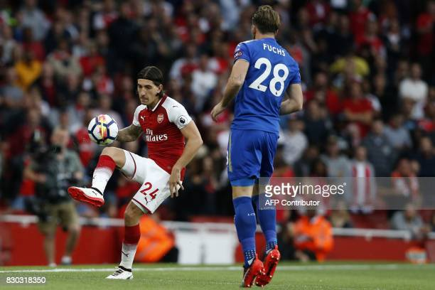 Arsenal's Spanish defender Hector Bellerin vies with Leicester City's Austrian defender Christian Fuchs during the English Premier League football...