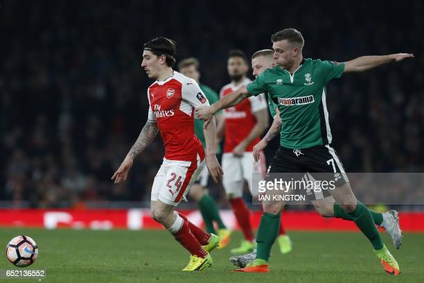 Arsenal's Spanish defender Hector Bellerin vies with Lincoln City's English striker Jack Muldoon during the English FA cup quarter final football...