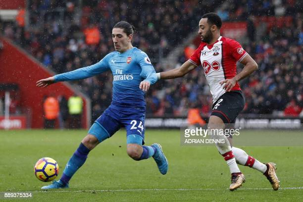 Arsenal's Spanish defender Hector Bellerin vies with Southampton's English midfielder Nathan Redmond during the English Premier League football match...