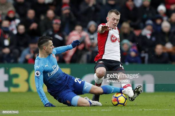 Arsenal's Spanish defender Hector Bellerin vies with Southampton's Serbian midfielder Dusan Tadic during the English Premier League football match...