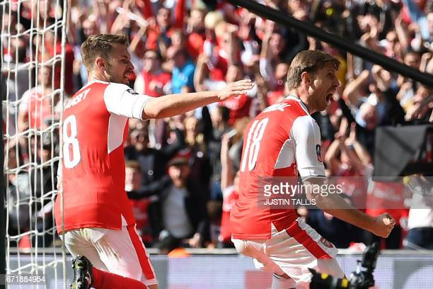 Arsenal's Spanish defender Nacho Monreal celebrates scoring their first goal during the FA Cup semifinal football match between Arsenal and...