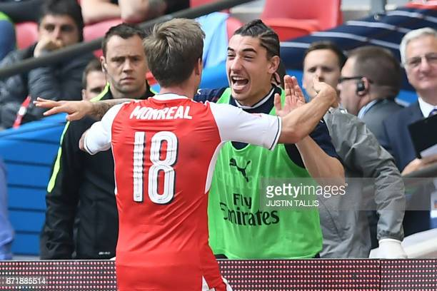 Arsenal's Spanish defender Nacho Monreal celebrates scoring their first goal with Arsenal's Spanish defender Hector Bellerin during the FA Cup...