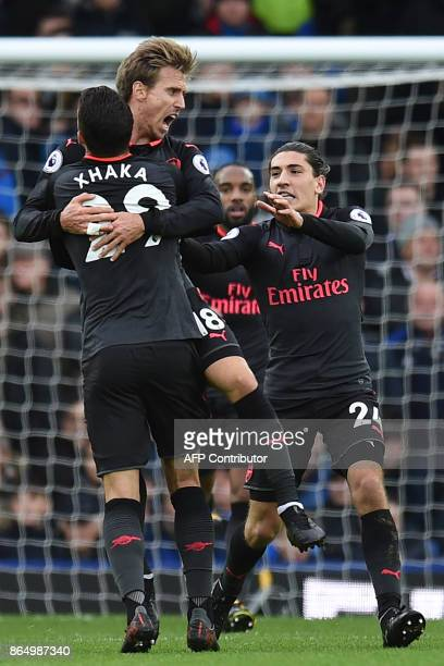 Arsenal's Spanish defender Nacho Monreal celebrates scoring their first goal to equalise 11 with Arsenal's Spanish defender Hector Bellerin and...