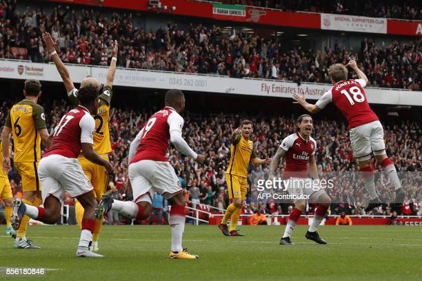 Arsenal's Spanish defender Nacho Monreal celebrates with Arsenal's Spanish defender Hector Bellerin scoring the team's first goal during the English...