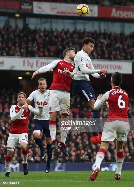 Arsenal's Spanish defender Nacho Monreal Tottenham Hotspur's English striker Harry Kane Arsenal's German defender Shkodran Mustafi Tottenham...