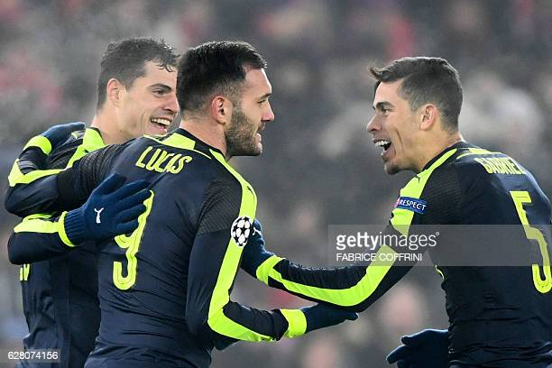 Arsenal's Spanish forward Lucas Perez celebrates after scoring a goal with his teammate Arsenal's Brazilian defender Gabriel during the UEFA...