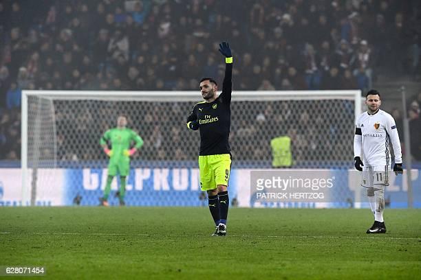 Arsenal's Spanish forward Lucas Perez celebrates his third goal next to Basel's Swiss midfielder Renato Steffen and Basel's Czech goalkeeper Tomas...