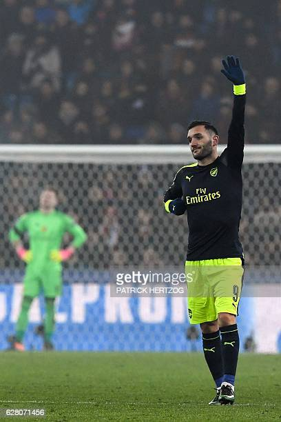 Arsenal's Spanish forward Lucas Perez celebrates his third goal next to Basel's Czech goalkeeper Tomas Vaclik during the UEFA Champions league Group...