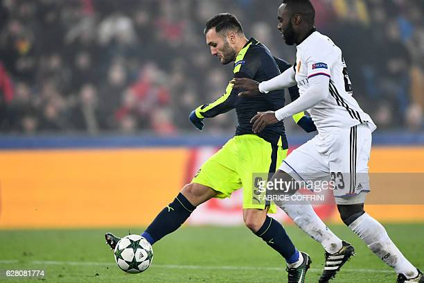 Arsenal's Spanish forward Lucas Perez vies with Basel's Colombian defender Eder Balanta during the UEFA Champions league Group A football match...