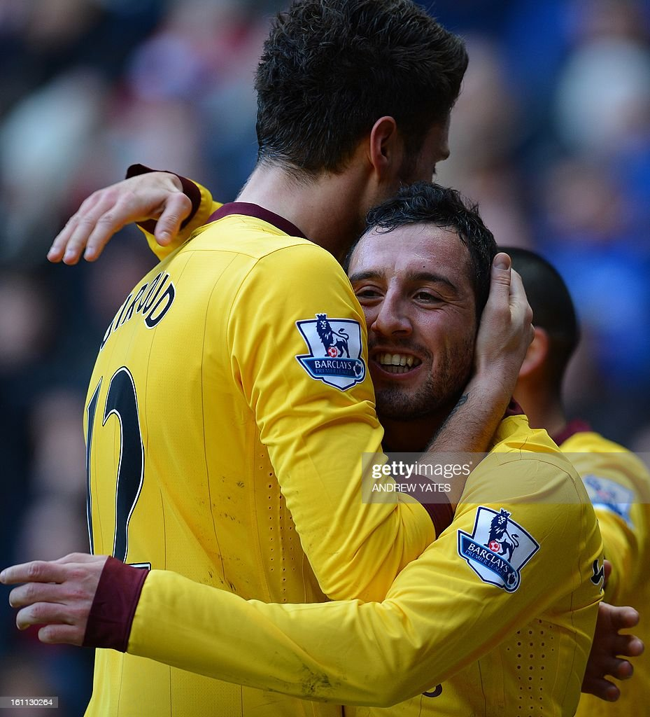"""Arsenal's Spanish midfielder Santi Cazorla (R) celebrates with Arsenal's French forward Olivier Giroud after scoring the opening goal during the English Premier League football match between Sunderland and Arsenal at The Stadium Of Light, in Sunderland, north-east England, on February 9, 2013. USE. No use with unauthorized audio, video, data, fixture lists, club/league logos or """"live"""" services. Online in-match use limited to 45 images, no video emulation. No use in betting, games or single club/league/player publications."""