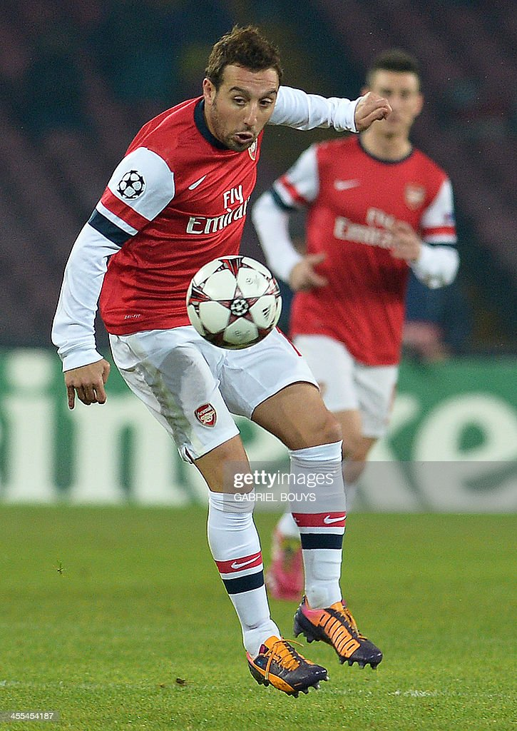 Arsenal's Spanish midfielder Santi Cazorla controls the ball during the UEFA Champions League group F football match between SSC Napoli and Arsenal FC at the San Paolo Stadium in Naples on December 11, 2013.