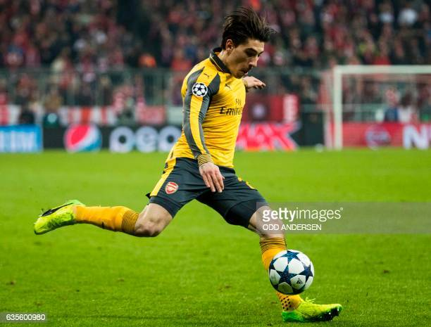 Arsenal's Spanish right back Hector Bellerin plays a cross during the UEFA Champions League round of sixteen football match between FC Bayern Munich...