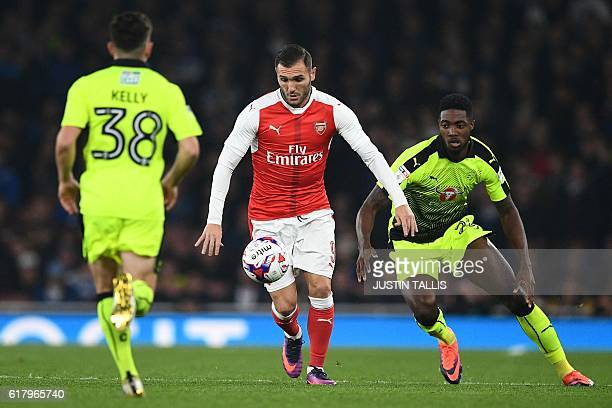 Arsenal's Spanish striker Lucas Perez controls the ball during the EFL Cup fourth round match between Arsenal and Reading at The Emirates Stadium in...