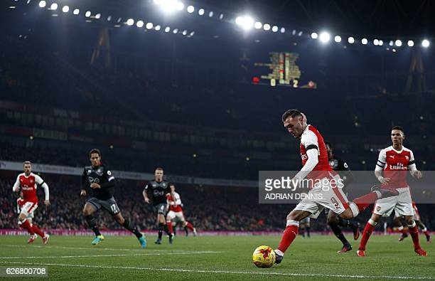 Arsenal's Spanish striker Lucas Perez crosses the ball during the EFL Cup quarterfinal football match between Arsenal and Southampton at the Emirates...