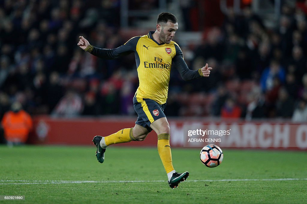 Arsenal's Spanish striker Lucas Perez runs at goal but fails to score during the English FA Cup fourth round football match between Southampton and Arsenal at St Mary's in Southampton, southern England on January 28, 2017. Arsenal won the match 5-0. / AFP / Adrian DENNIS / RESTRICTED TO EDITORIAL USE. No use with unauthorized audio, video, data, fixture lists, club/league logos or 'live' services. Online in-match use limited to 75 images, no video emulation. No use in betting, games or single club/league/player publications. /