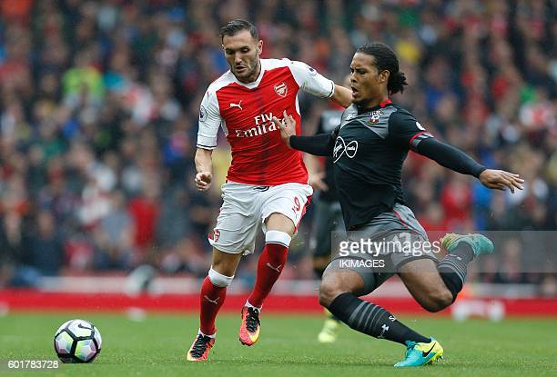Arsenal's Spanish striker Lucas Perez vies with Southampton's Dutch defender Virgil van Dijk during the English Premier League football match between...