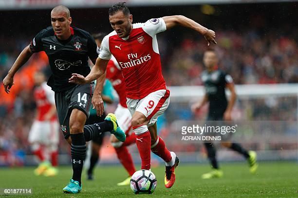 Arsenal's Spanish striker Lucas Perez vies with Southampton's Sepanish midfielder Oriol Romeu during the English Premier League football match...