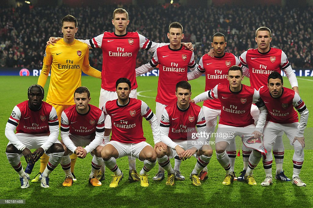 Arsenal's starting eleven (L-R top row), Polish goalkeeper Wojciech Szczesny, German defender Per Mertesacker, French defender Laurent Koscielny, English midfielder Theo Walcott, German striker Lukas Podolski (L-R bottom row) French defender Bacary Sagna, English midfielder Jack Wilshere, Spanish midfielder Mikel Arteta, Welsh midfielder Aaron Ramsey, Belgian defender Thomas Vermaelen and Arsenal's Spanish midfielder Santi Cazorla line up for the team picture at the start of the UEFA Champions League round of 16 football match between Arsenal and Bayern Munich at the Emirates Stadium in north London on February 19, 2013. Bayern Munich won 3-1.