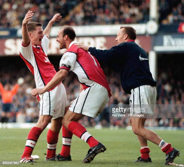 Arsenal's Stephen Hughes celebrates with Steve Bould and Lee Dixon after scoring the equalizer against Leicester during the Premiership clash between...