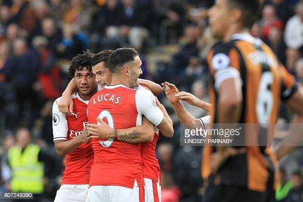 Arsenal's Swiss midfielder Granit Xhaka celebrates with Arsenal's Egyptian midfielder Mohamed Elneny after scoring their fourth goal during the...