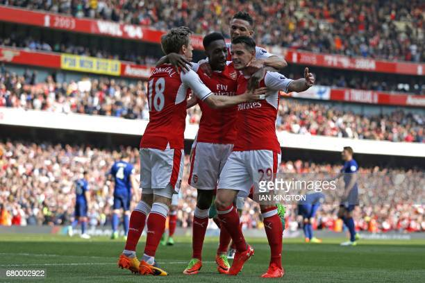Arsenal's Swiss midfielder Granit Xhaka celebrates with Arsenal's Spanish defender Nacho Monreal Arsenal's English striker Danny Welbeck and...