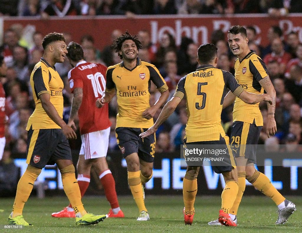 Arsenal's Swiss midfielder Granit Xhaka (R) celebrates with teammates after scoring the opening goal of the English League Cup third round football match between Nottingham Forest and Arsenal at The City Ground in Nottingham, central England on September 20, 2016. / AFP / Lindsey PARNABY / RESTRICTED TO EDITORIAL USE. No use with unauthorized audio, video, data, fixture lists, club/league logos or 'live' services. Online in-match use limited to 75 images, no video emulation. No use in betting, games or single club/league/player publications. /