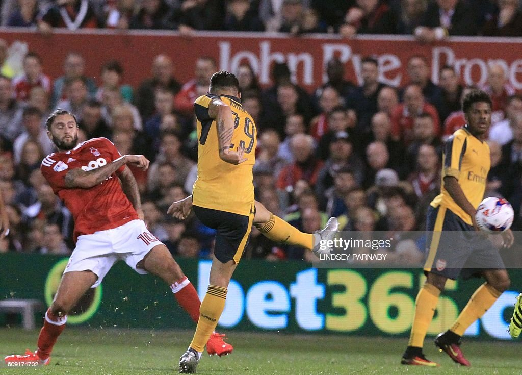 Arsenal's Swiss midfielder Granit Xhaka (2nd L) shoots to score the opening goal of the English League Cup third round football match between Nottingham Forest and Arsenal at The City Ground in Nottingham, central England on September 20, 2016. / AFP / Lindsey PARNABY / RESTRICTED TO EDITORIAL USE. No use with unauthorized audio, video, data, fixture lists, club/league logos or 'live' services. Online in-match use limited to 75 images, no video emulation. No use in betting, games or single club/league/player publications. /
