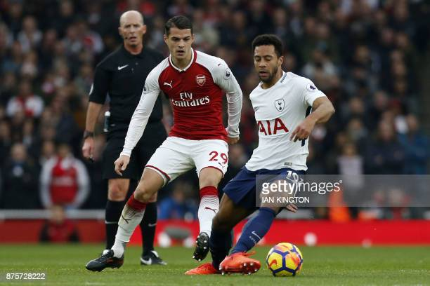 Arsenal's Swiss midfielder Granit Xhaka vies with Tottenham Hotspur's Belgian midfielder Mousa Dembele during the English Premier League football...