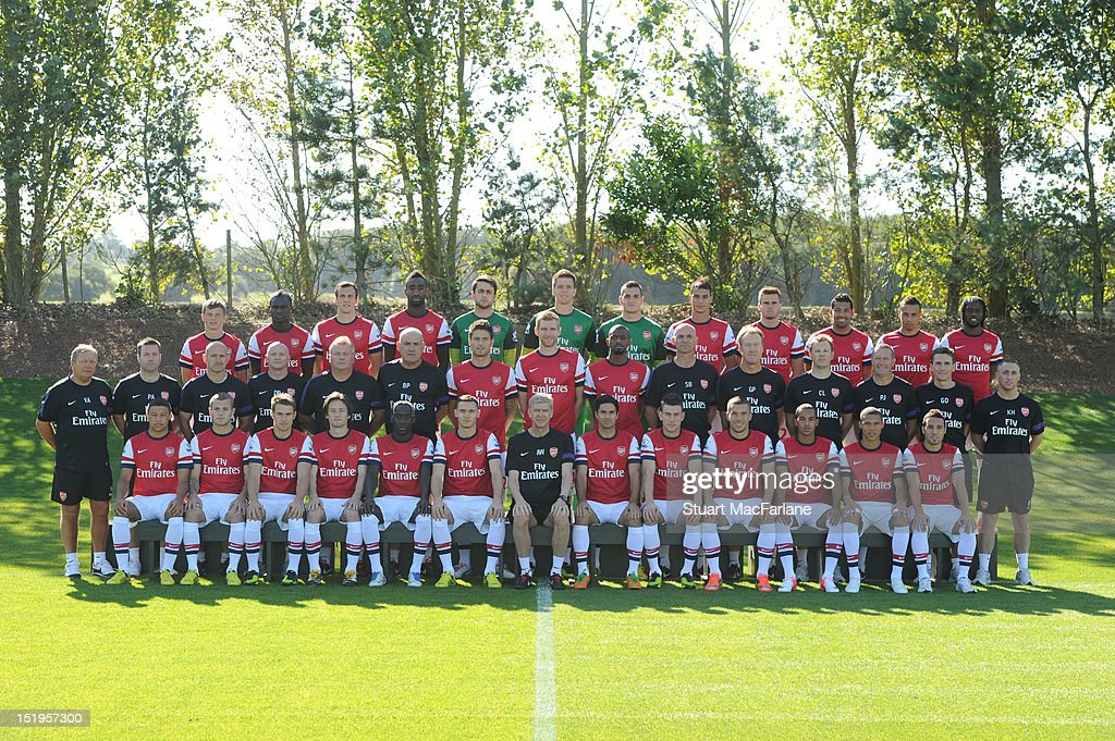 Arsenal's Team Squad pose for their 2012 - 2013 season first team photocall: (Back row) (L-R): Andrey Arshavin, Emmanuel Frimpong, Sebastien Squillaci, Johan Djourou, Lukasz Fabianski, Wojciech Szczesny, Vito Mannone, Marouane Chamakh, Carl Jenkinson, Andre Santos, Francis Coquelin, Gervinho. Middle row (L-R): Vic Akers (kit manager), Paul Akers (assistant kit manager), Tony Colbert (fitness coach), Darren Page (masseur), Neil Banfield (first team coach), Boro Primorac (first team coach), Olivier Giroud, Per Mertesacker, Abou Diaby, Steve Bould (assistant manager), Gerry Peyton (goalkeeping coach), Colin Lewin (physiotherapist), Paul Johnson (equipment manager), Dr Gary O'Driscoll (club doctor), Kieran Hunt (masseur). Front row (L-R): Alex Oxlade-Chamberlain, Jack Wilshere, Aaron Ramsey, Tomas Rosicky, Bacary Sagna, Thomas Vermaelen (captain), Arsene Wenger (manager) Mikel Arteta, Laurent Koscielny, Lukas Podolski, Theo Walcott, Kieran Gibbs, Santi Cazorla at the Arsenal Training Ground on September 13, 2011 in London, England.