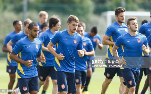 Arsenal's Theo Walcott Aaron Ramsey and Jack Wilshere during a training session at London Colney St Albans