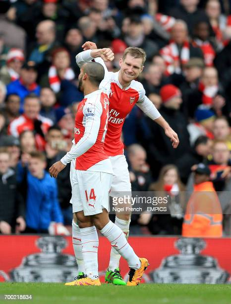 Arsenal's Theo Walcott and Arsenal's Per Mertesacker celebrate after the final whistle