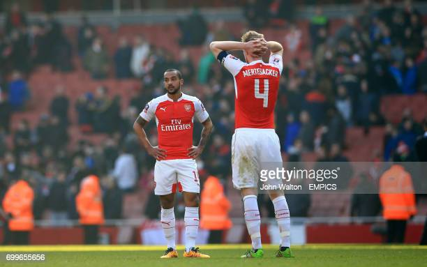 Arsenal's Theo Walcott and Arsenal's Per Mertesacker show dejection after the final whistle